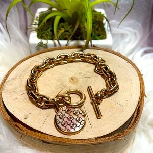 Michael Kors Bracelet rose gold mono logo toggle